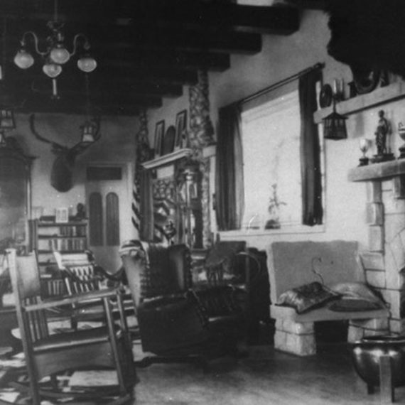 The Mansion's living room has seen many changes over the years. This photo was taken sometime during John Springer's ownership from 1897-1913, and shows a window where the arched doorway into the dining room now sits.