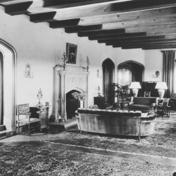 The Mansion's living room received its final transformation during Frank Kistler's 1926-1937 ownership, with the addition of large arched doorways and an intricately carved travertine mantle.
