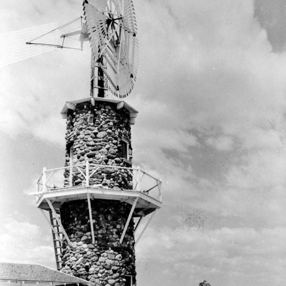 The ranch's iconic windmill, photographed in the 1930s. The date of construction for the windmill is unknown, but historians expect it was as early as the turn of the 20th century.