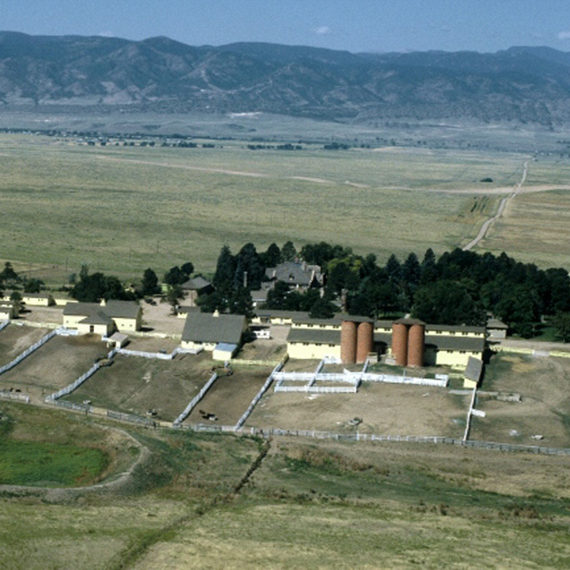 Aerial view of the Highlands Ranch headquarters, including the Mansion and ranch buildings, looking west toward the Front Range. Photo taken in late 1970s.
